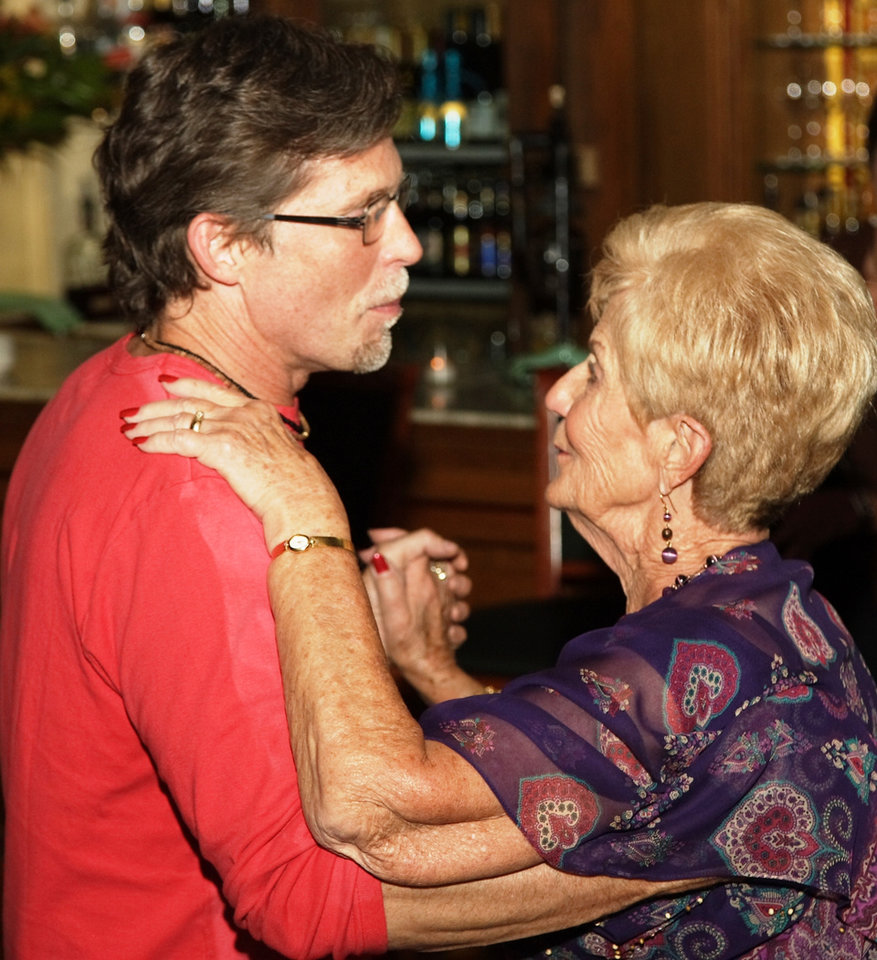 After preparing a meal for 180 of his mother's friends, Rick Bayless shed his chef's coat later in the evening to have another dance with his mother Levita Anderson.