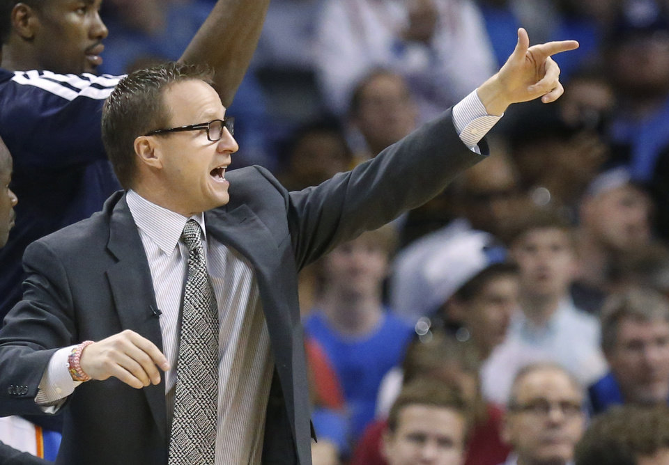 Photo -  Oklahoma City Thunder head coach Scott Brooks shouts in the fourth quarter of an NBA basketball game against the Los Angeles Clippers in Oklahoma City, Sunday, Feb. 23, 2014. Los Angeles won 125-117. (AP Photo/Sue Ogrocki)