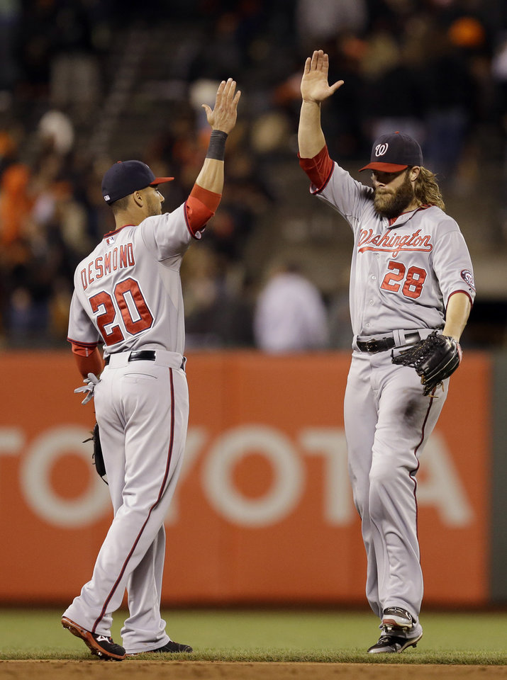 Photo - Washington Nationals' Ian Desmond (20) and Jayson Werth, right, celebrate the 2-1 defeat of the San Francisco Giants at the end of a baseball game Tuesday, June 10, 2014, in San Francisco. (AP Photo/Ben Margot)