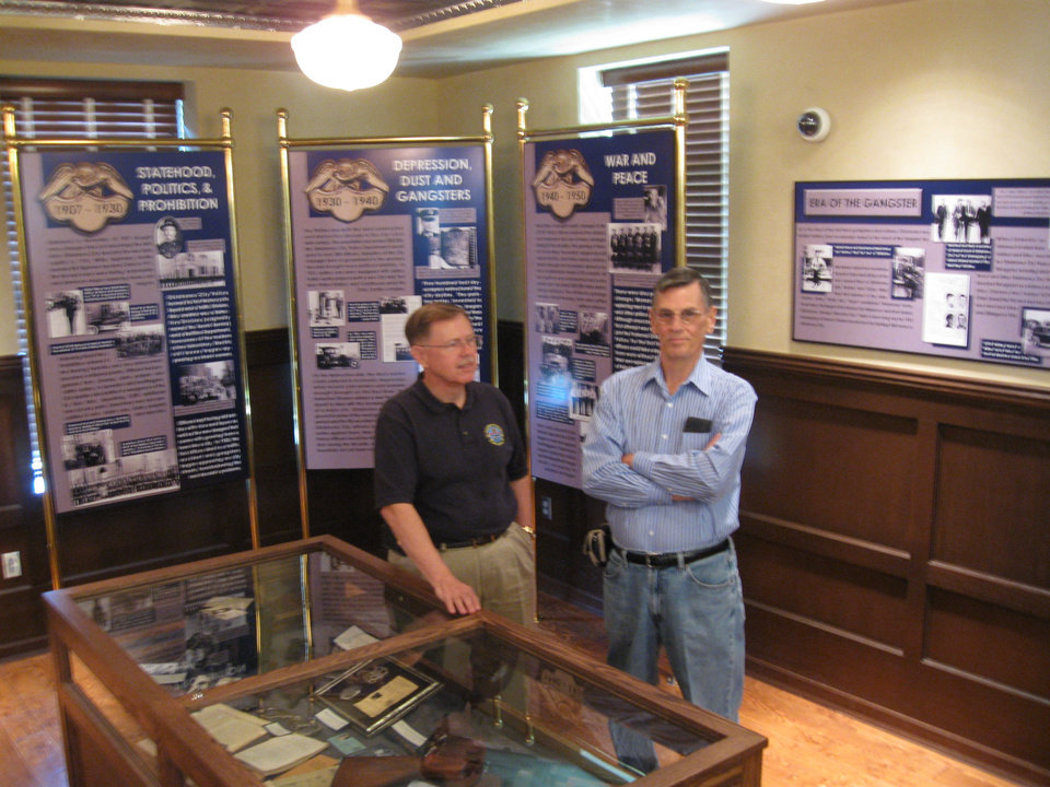 Photo - Maj. Ed Hill and retired Oklahoma City police detective Ron Owens guided the creation of an exhibit on the department's history at the Bricktown Police Substation. Photo by Steve Lackmeyer, The Oklahoman