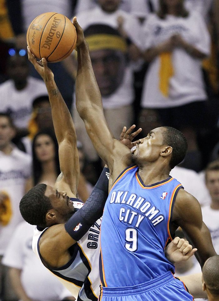 Photo - Oklahoma City Thunder forward Serge Ibaka (9) blocks a shot by Memphis Grizzlies guard Mike Conley, left, during the first half of Game 3 of a second-round NBA basketball series on Saturday, May 7, 2011, in Memphis, Tenn. (AP Photo/Lance Murphey) ORG XMIT: TNMH104