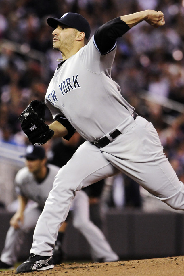 Photo -   New York Yankees pitcher Andy Pettitte throws against the Minnesota Twins in the first inning of a baseball game, Monday, Sept. 24, 2012, in Minneapolis. (AP Photo/Jim Mone)