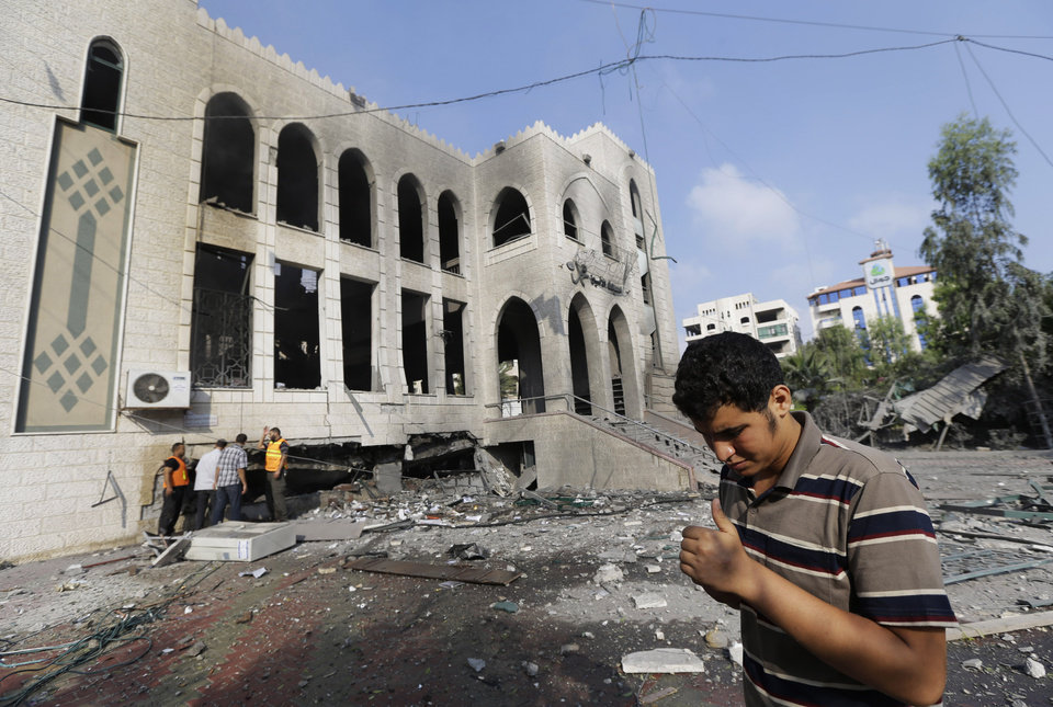 Photo - Palestinians inspect the damage at the Ameen mosque in Gaza City, northern Gaza Strip, destroyed by an Israeli strike, Tuesday, July 29, 2014. Early Tuesday, Israel warplanes struck a series of targets in Gaza City, including the top Hamas leader in Gaza, Ismail Haniyeh's house and government offices, while Gaza's border area with Israel was hit by heavy tank shelling. (AP Photo/Lefteris Pitarakis)