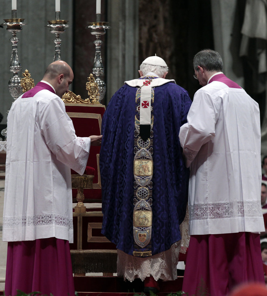 Photo - Pope Benedict XVI is helped by master of ceremonies to walk on the altar as he celebrates the Ash Wednesday mass in St. Peter's Basilica at the Vatican, Wednesday, Feb. 13, 2013.  Ash Wednesday marks the beginning of Lent, a solemn period of 40 days of prayer and self-denial leading up to Easter. Pope Benedict XVI told thousands of faithful Wednesday that he was resigning for