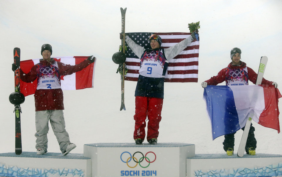Photo - Gold medalist David Wise of the United States, center, celebrates with silver medalist Mike Riddle of Canada, left, and bronze medalist Kevin Rolland of France, after the men's ski halfpipe final at the Rosa Khutor Extreme Park, at the 2014 Winter Olympics, Tuesday, Feb. 18, 2014, in Krasnaya Polyana, Russia.  (AP Photo/Sergei Grits)