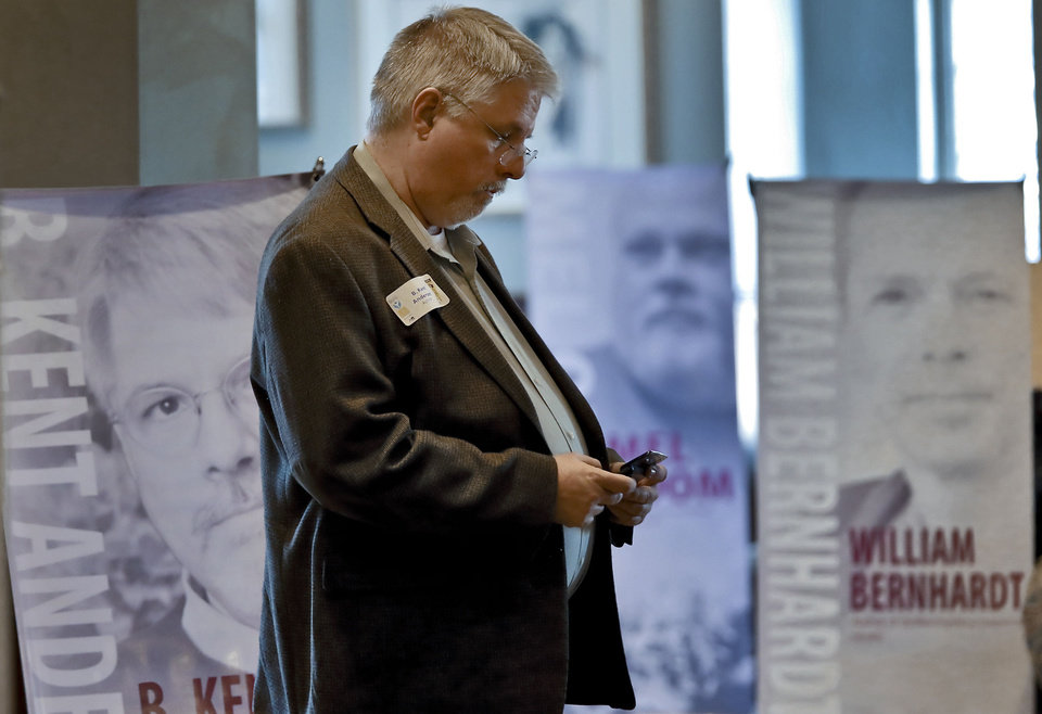 Author B. Kent Anderson uses his phone during a meet-the-author event at the Oklahoma Memorial Union in Norman that marked the start of the Pioneer Library System's Big Read campaign. PHOTO BY CHRIS LANDSBERGER, THE OKLAHOMAN <strong>CHRIS LANDSBERGER</strong>