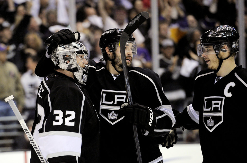 Photo -   Los Angeles Kings defenseman Drew Doughty, center, and right wing Dustin Brown, right, congratulate goalie Jonathan Quick after Game 3 of an NHL hockey Stanley Cup second-round playoff series against the St. Louis Blues, Thursday, May 3, 2012, in Los Angeles. The Kings won 4-2. (AP Photo/Mark J. Terrill)