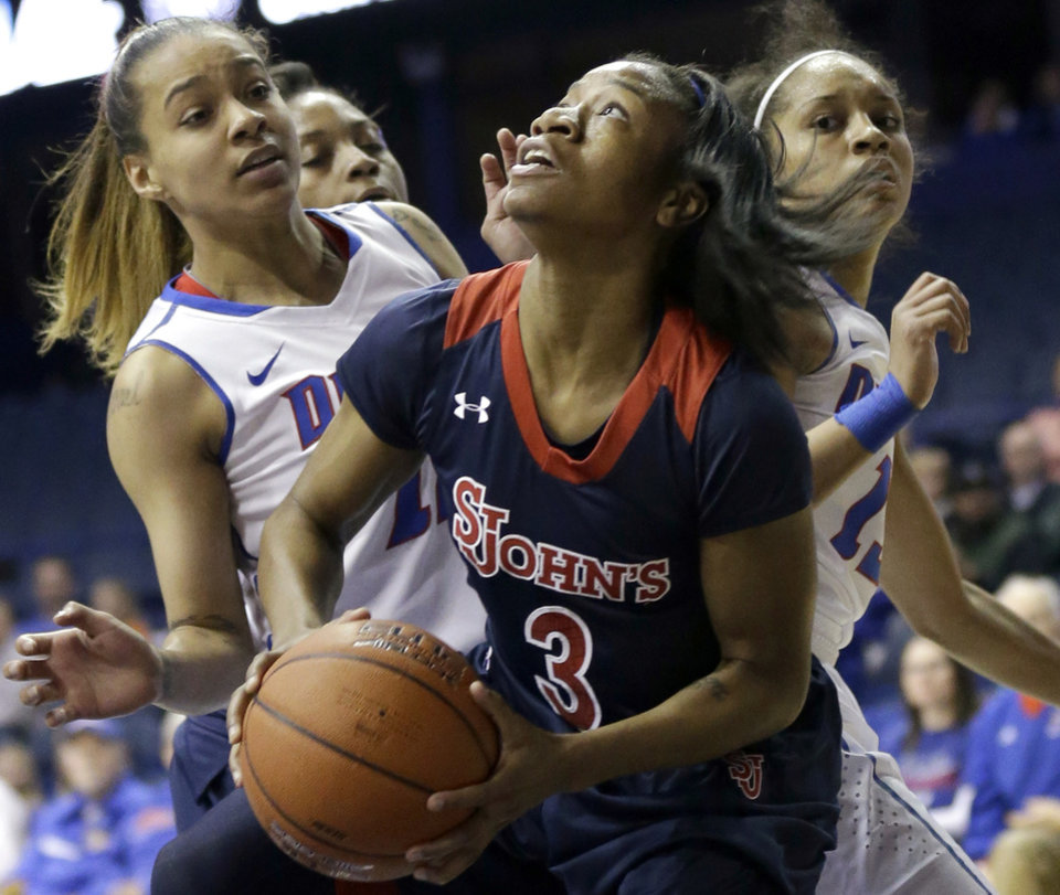 Photo - St. John's guard Aliyyah Handford (3) looks up the basket as DePaul guards Brittany Hrynko, left, and Chanise Jenkins, right, defend during the first half of an NCAA women's college basketball game in the final of the 2014 Big East basketball tournament in Rosemont, Ill., Tuesday, March 11, 2014. (AP Photo/Nam Y. Huh)