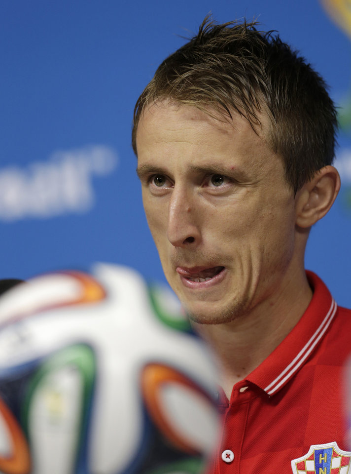 Photo - Luka Modric of Croatia grimaces during a press conference after a training session at the Arena Pernambuco in Recife, Brazil, Sunday, June 22, 2014. Croatia will play Mexico in group A of the 2014 soccer World Cup. (AP Photo/Petr David Josek)
