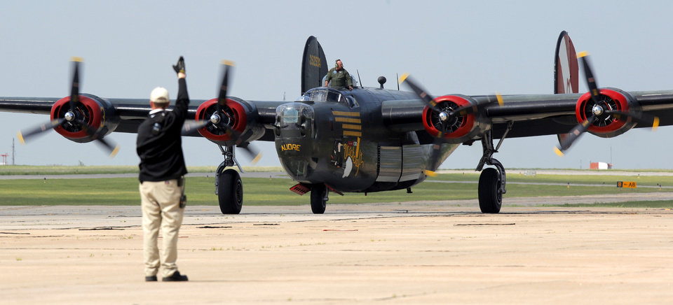 A Consolidated B-24 Liberator taxis to Valair Aviation after landing at Wiley Post Airport as part of the Wings of Freedom Tour in Bethany, Okla., Friday, April 6, 2012. The Wings of Freedom Tour travels the country with vintage World War II aircraft to show the public as a living history display. Photo by Nate Billings, The Oklahoman