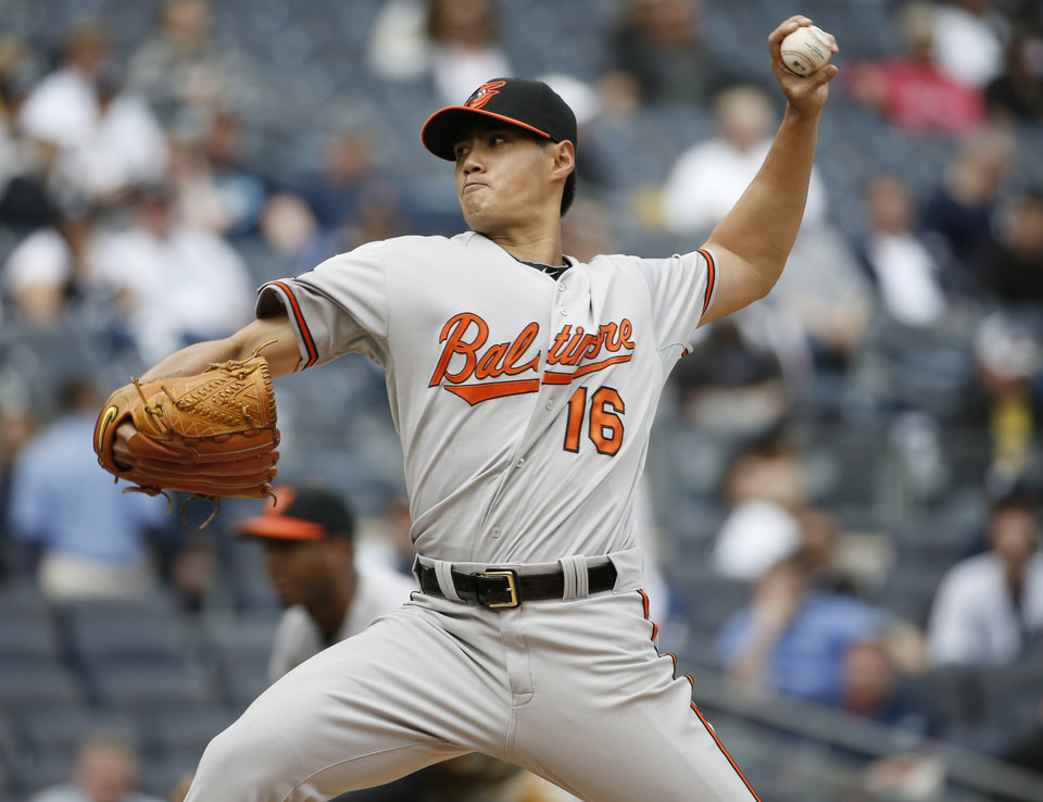 Photo - Baltimore Orioles starting pitcher Wei-Yin Chen delivers in the fourth inning of a baseball game against the New York Yankees at Yankee Stadium in New York, Tuesday, April 8, 2014.  (AP Photo/Kathy Willens)
