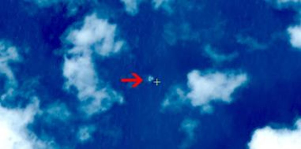 Photo - In this March 9, 2014 satellite image seen on the website of the Chinese State Administration of Science, Technology and Industry for National Defense, floating objects are seen at sea next to the red arrow which was added by the source.  China's Xinhua News Agency reported Wednesday that the images show suspected debris from the missing Malaysia Airlines jetliner floating off the southern tip of Vietnam. (AP Photo/Chinese State Administration of Science, Technology and Industry for National Defense)