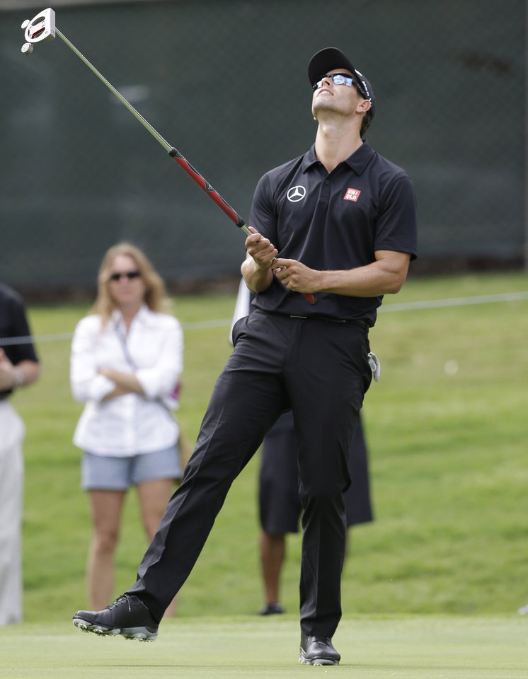 Photo - Adam Scott reacts to missing a putt on the first hole during the first round of the PGA Colonial golf tournament in Fort Worth, Texas, Thursday, May 22, 2014.   (AP Photo/LM Otero)