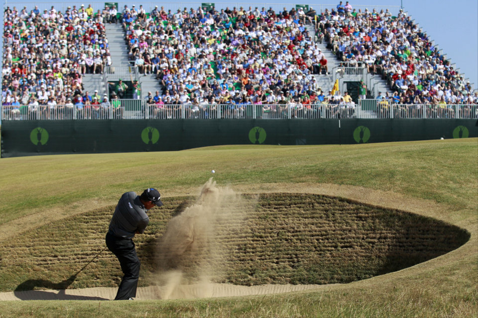 Lee Westwood of England plays out of a bunker on the 4th hole during the second round of the British Open Golf Championship at Muirfield, Scotland, Friday July 19, 2013. (AP Photo/Peter Morrison)
