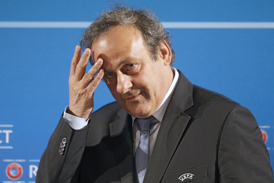 Photo - FILE - In this Feb.22, 2014 file photo, UEFA President Michel Platini arrives at a press conference, one day prior to the UEFA EURO 2016 qualifying draw in Nice, southeastern France. Michel Platini will not challenge Sepp Blatter for the FIFA presidency, saying Thursday Aug.28, 2014  there was