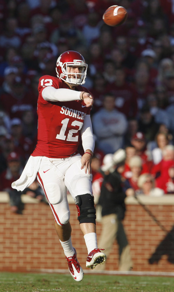 Photo - Quarterback Landry Jones (12) throws during the first half of the college football game between the University of Oklahoma Sooners (OU) and the Texas Tech Red Raiders (TTU) at the Gaylord Family Memorial Stadium on Saturday, Nov. 13, 2010, in Norman, Okla.  Photo by Steve Sisney, The Oklahoman