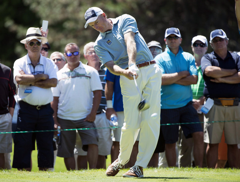 Photo - Jim Furyk, of the United States, hits off the second tee during first-round play at the Canadian Open golf championship on Thursday, July 24, 2014, in Montreal. (AP Photo/The Canadian Press, Paul Chiasson)