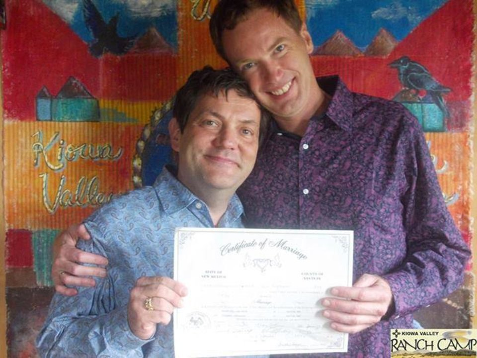 Photo - Tom Kovach, left, and his partner Will Weir show off their marriage license. The couple were married in New Mexico in September. Kovach is believed to be the only gay elected official in Oklahoma who is legally married.   - PHOTO PROVIDED