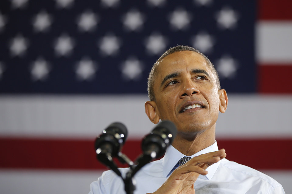 Photo - President Barack Obama speaks about raising the minimum wage, Wednesday, Jan. 29, 2014, at a Costco store in Lanham, Md., the morning after his State of the Union address. (AP Photo/Charles Dharapak)