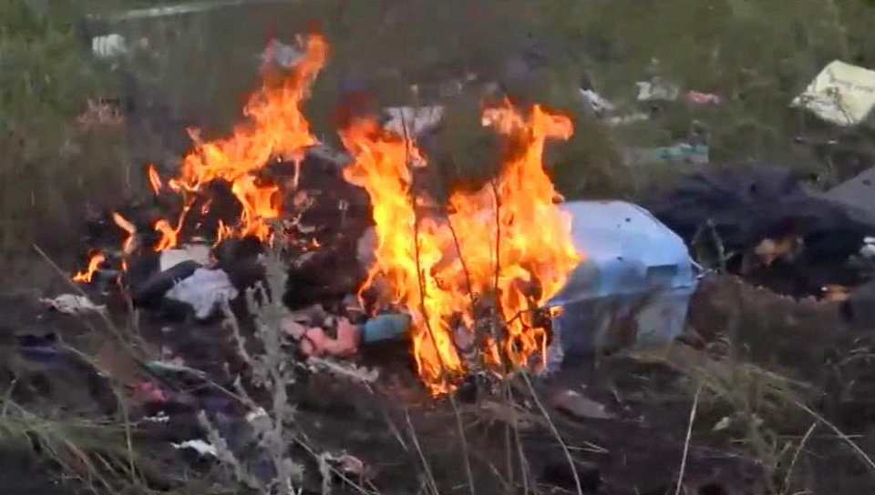 Photo - In this image taken from video, Thursday July 17, 2014, showing flames rising from part of the wreckage of a passenger plane carrying 295 people after it was shot down Thursday as it flew over Ukraine, near the village of Hrabove, in eastern Ukraine. Malaysia Airlines tweeted that it lost contact with one of its flights as it was traveling from Amsterdam to Kuala Lumpur over Ukrainian airspace. (AP Photo / Channel 1) RUSSIA OUT - TV OUT