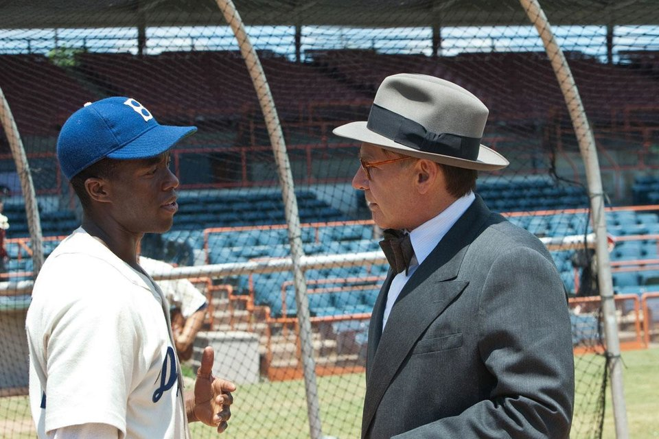 From left, Chadwick Boseman and Harrison Ford star in in the baseball biopic