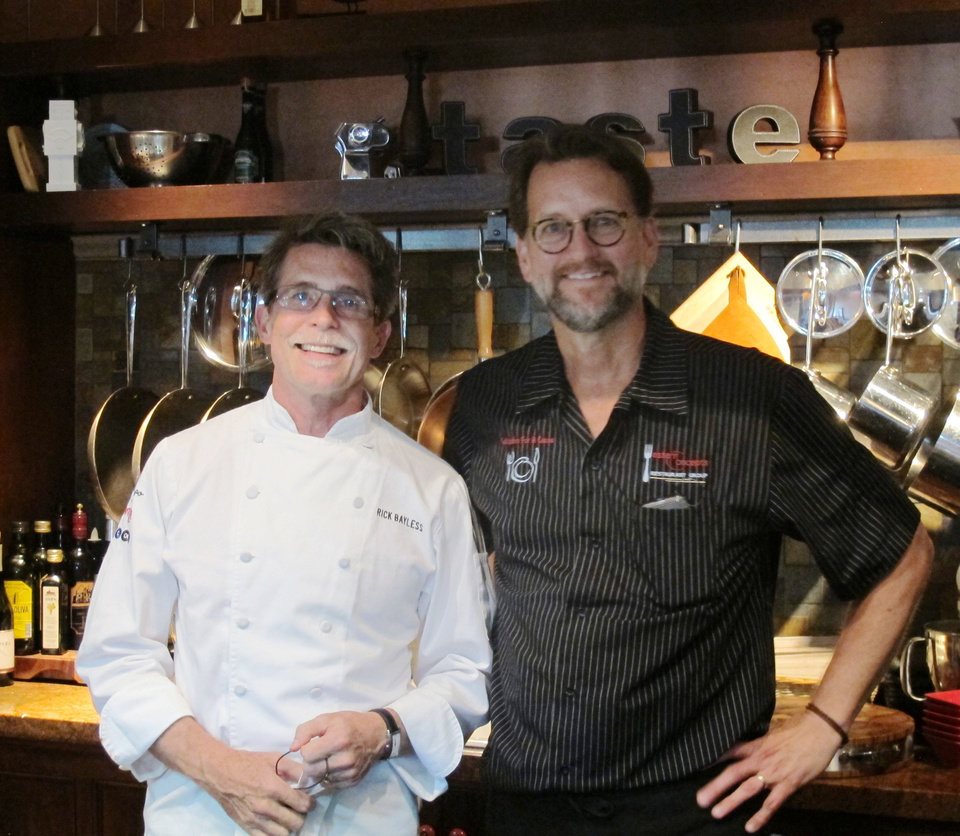 Photo - Chefs Rick Bayless, left, and Kurt Fleischfresser partnered with other local Oklahoma chefs to execute Monday's OK Chefs Relief triple pop-up restaurant event.  THE OKLAHOMAN - DAVE CATHEY
