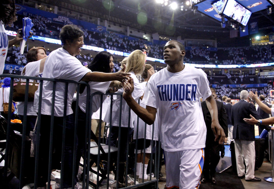 Photo - Oklahoma City's Kevin Durant (35) leaves the court following game five of the Western Conference semifinals between the Memphis Grizzlies and the Oklahoma City Thunder in the NBA basketball playoffs at Oklahoma City Arena in Oklahoma City, Wednesday, May 11, 2011. Photo by Sarah Phipps, The Oklahoman