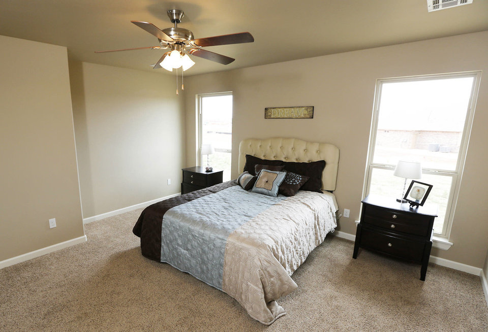 The 1,950-square-foot TimberCraft model home has a spacious master bedroom.