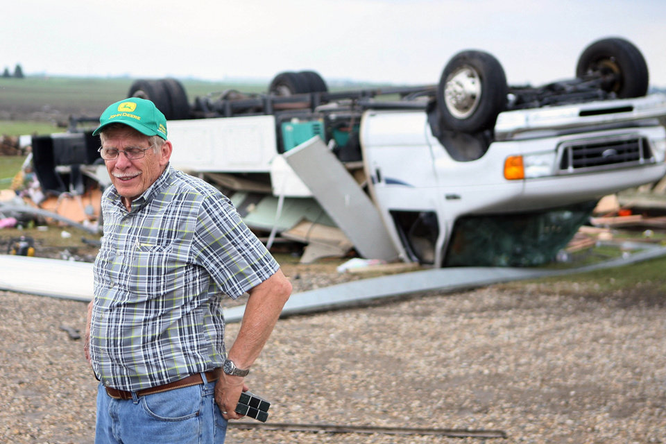 "Ken and Sandy Dorenkamp's motor home was destroyed after a tornado struck the area on Wednesday, June 12, 2013 in Alexander, Iowa. Authorities are receiving reports of homes and businesses ""completely damaged"" by severe weather and multiple tornadoes in northern Iowa. (AP Photo/The Globe Gazette, Arian Schuessler)"
