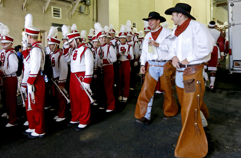 Photo - The OU band waits to take the field Texas Cowboys walk past during before the Red River Showdown college football game between the University of Oklahoma Sooners (OU) and the University of Texas Longhorns (UT) at the Cottonbowl in Dallas on Saturday, Oct. 11, 2014. 
