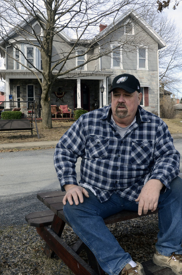 Photo - Paul Garrett sits in front of his home in Jersey Shore, Pa. on Sunday March 23, 2014. With an expected increase in flood insurance rates, he says,