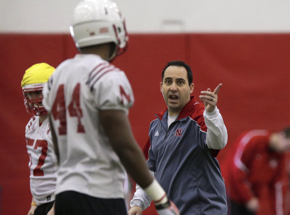 Photo - Nebraska defensive coordinator John Papuchis talks to defensive end Randy Gregory (44) on the first day of spring NCAA college football practice in Lincoln, Neb., Saturday, March 8, 2014. (AP Photo/Nati Harnik)