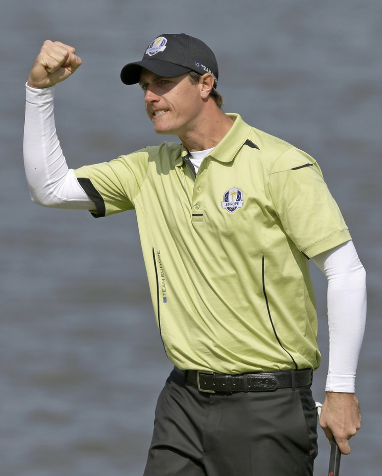 Photo -   Europe's Nicolas Colsaerts reacts after making a birdie putt on the second hole during a four-ball match at the Ryder Cup PGA golf tournament Friday, Sept. 28, 2012, at the Medinah Country Club in Medinah, Ill. (AP Photo/Chris Carlson)