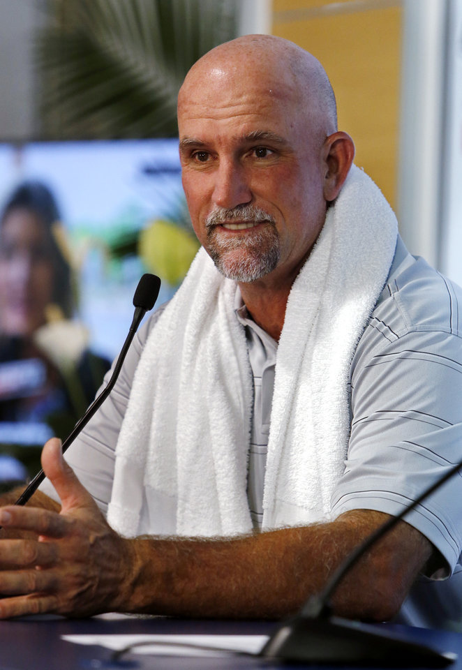 Photo - Marco Dawson speaks to the media following the first round of the U.S. Senior Open Championship golf tournament at Oak Tree National in Edmond, Okla. on Thursday, July 10, 2014. Photo by Steve Sisney, The Oklahoman