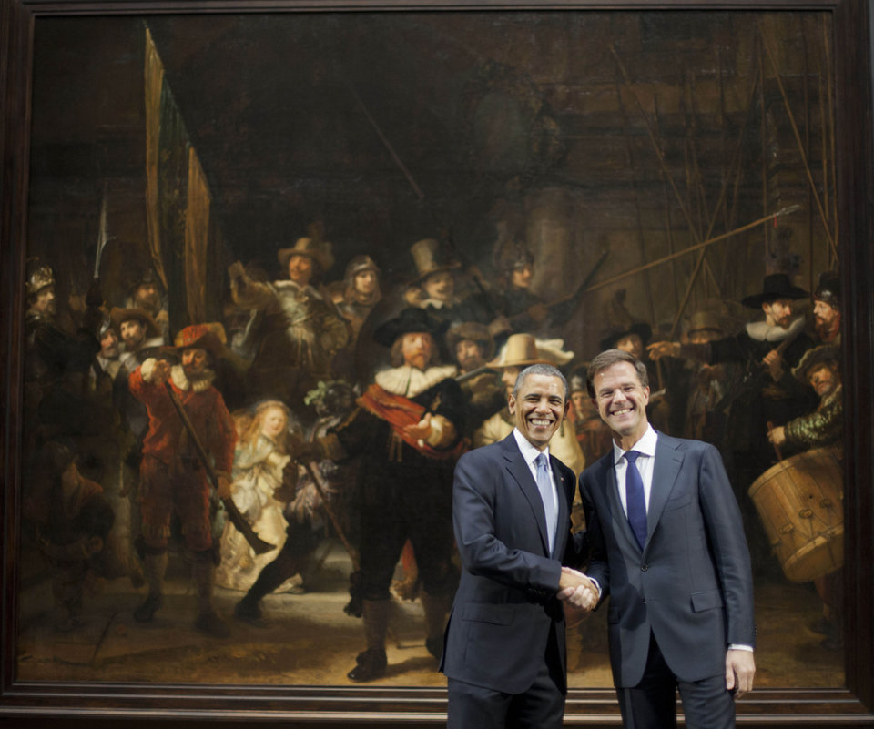 Photo - U.S. President Barack Obama, left, and Prime Minister of the Netherlands Mark Rutte, right, shakes hands as they pose for photos in front of Rembrandt's