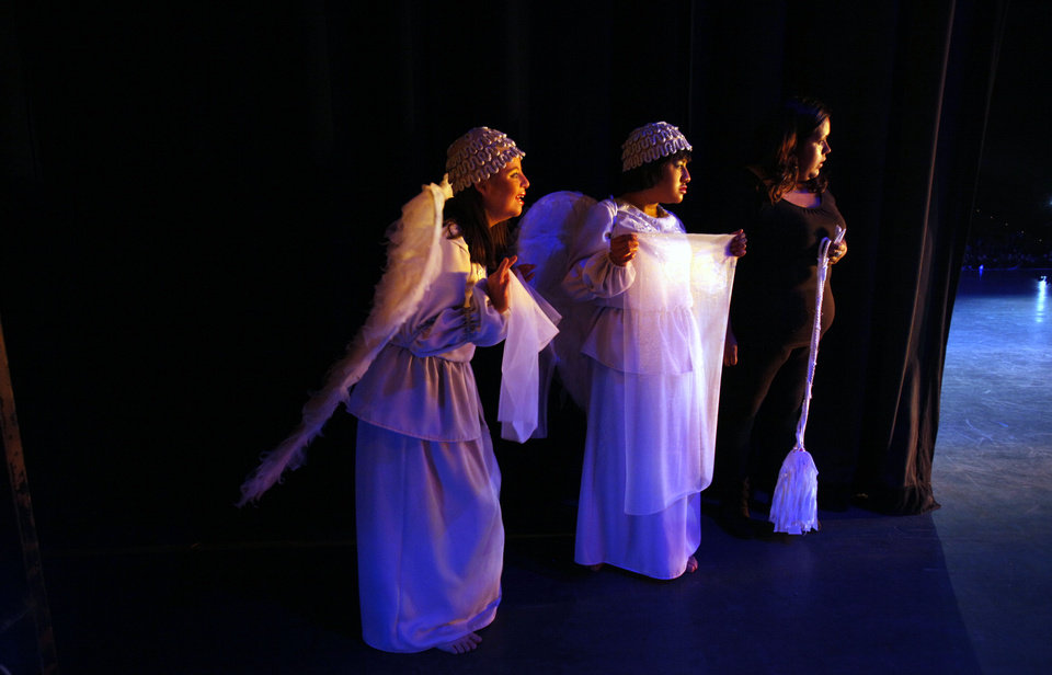 "In this Sept. 21, 2012 photo, actresses wait in the wings for their turn to walk on stage during a performance of ""Suenos,"" or �Dreams,� one of Ecuador's most successful musicals, at the Casa de la Cultura theater in Quito, Ecuador. The musical is based in part on the dreams of young people with disabilities and is presented by the nonprofit foundation El Triangulo. (AP Photo/Dolores Ochoa)"