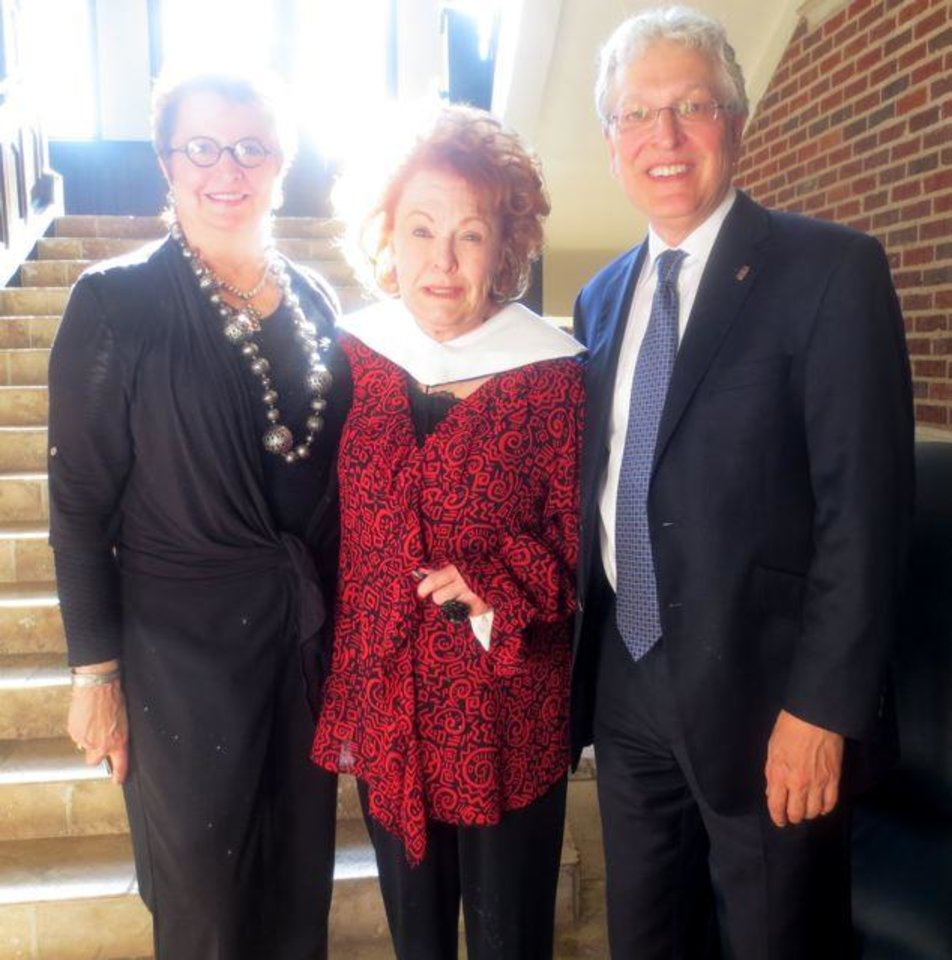 Justice Yvonne Kauger, Bobbie Burbridge Lane and Dr. Robert Henry were at the dedication. Bobbie Burbridge Lane donated a life-sized marble statue of the biblical �Ruth� by R. Romanelli Fiernze, 1911, to Oklahoma City University. It was from the Burbridge Foundation�s Collection of Art. (Photo by Helen Ford Wallace).