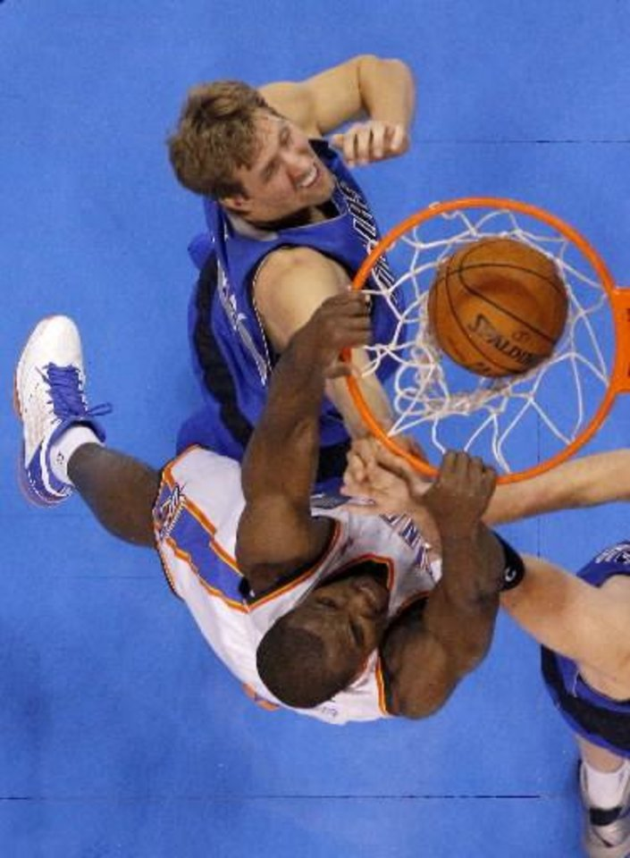Serge Ibaka dunks over Dirk Nowitzki of Dallas in Thursday night's 111-105 overtime victory against the Mavericks. (Photo by Bryan Terry, The Oklahoman)
