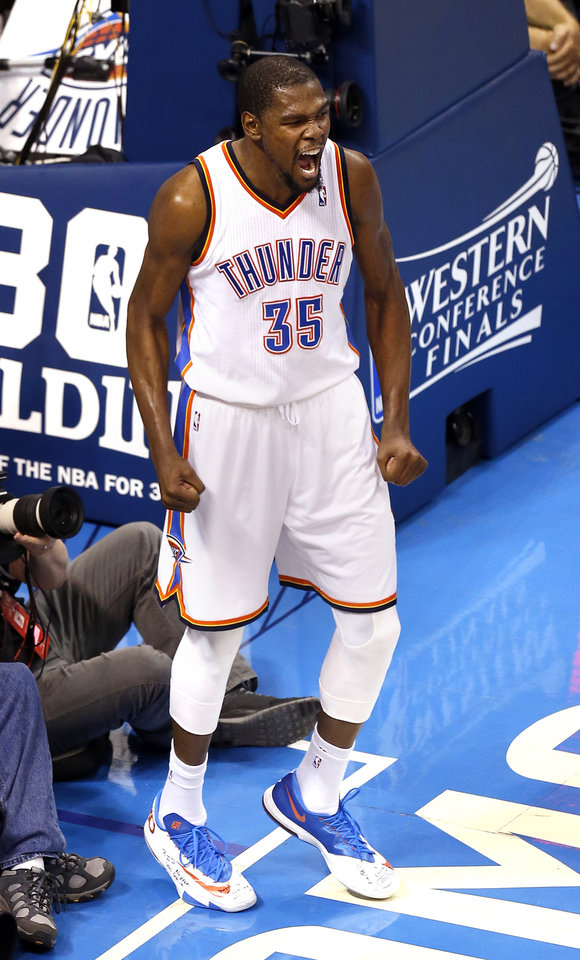 Photo - Oklahoma City's Kevin Durant (35) celebrates during Game 6 of the Western Conference Finals in the NBA playoffs between the Oklahoma City Thunder and the San Antonio Spurs at Chesapeake Energy Arena in Oklahoma City, Saturday, May 31, 2014. Photo by Nate Billings, The Oklahoman