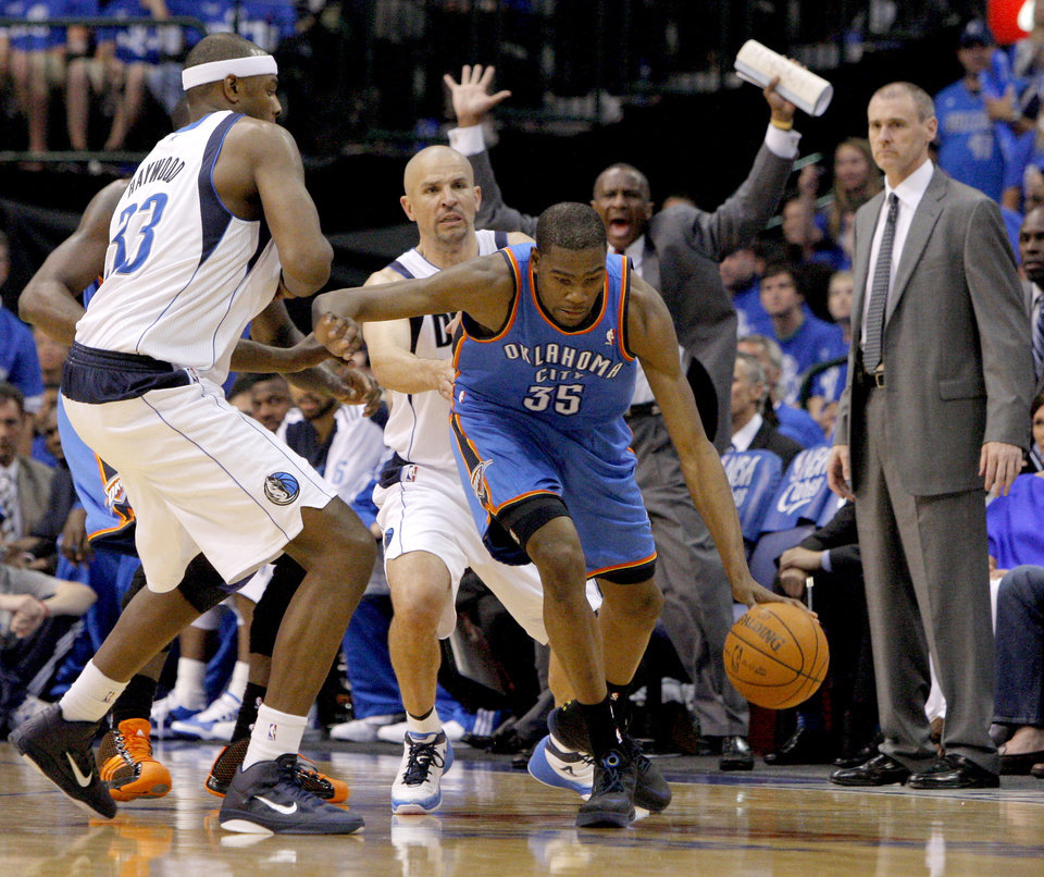 Photo - Oklahoma City's Kevin Durant (35) tries to get around Brendan Haywood (33) of Dallas and Jason Kidd (2) during game 1 of the Western Conference Finals in the NBA basketball playoffs between the Dallas Mavericks and the Oklahoma City Thunder at American Airlines Center in Dallas, Tuesday, May 17, 2011. Photo by Bryan Terry, The Oklahoman