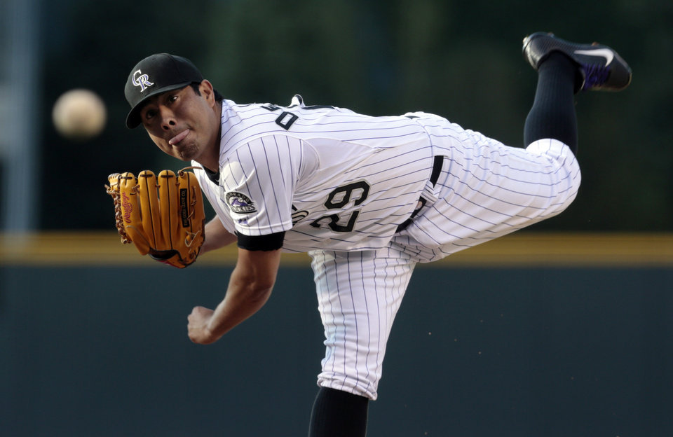 Colorado Rockies starting pitcher Jorge De La Rosa delivers against the Chicago Cubs in the first inning of a baseball game in Denver, Friday, July 19, 2013. (AP Photo/Joe Mahoney)