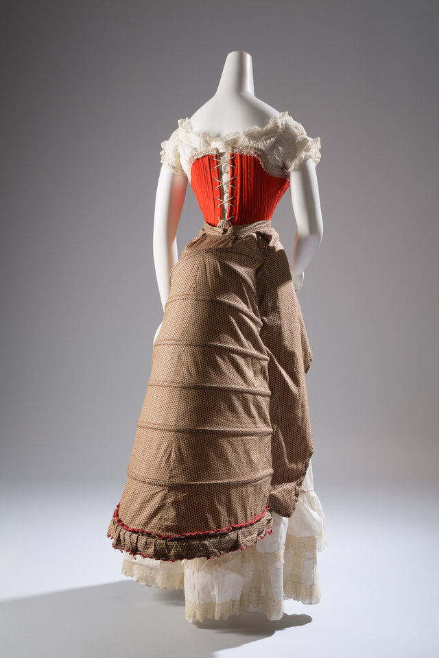 Photo - This image released by The Museum at FIT shows a corset in wool, silk cotton and steel from 1880s France.  From a 1770 corset to a 2014 bra-and-panty set in lacy stretch silk, the Museum at the Fashion Institute of Technology has taken on lingerie and ladies foundation garments as the focus of a new exhibition. In about 70 pieces,