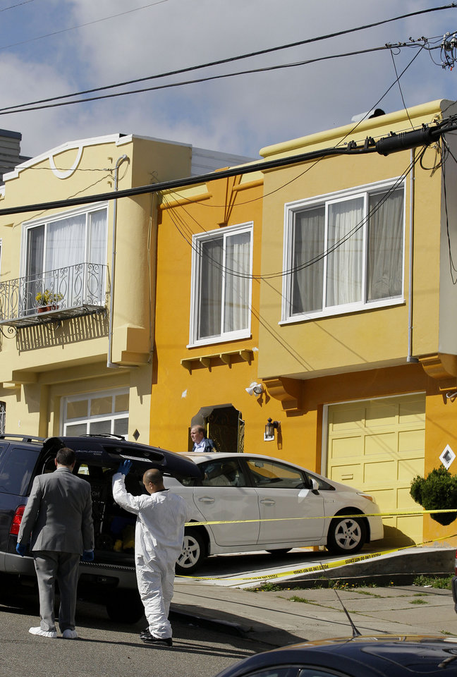 San Francisco Police officers inspect outside of a home on Howth Street in San Francisco, Friday, March 23, 2012. Five members of a family were found dead inside a home near San Francisco's City College in an apparent murder-suicide, police said Friday. (AP Photo/Jeff Chiu)