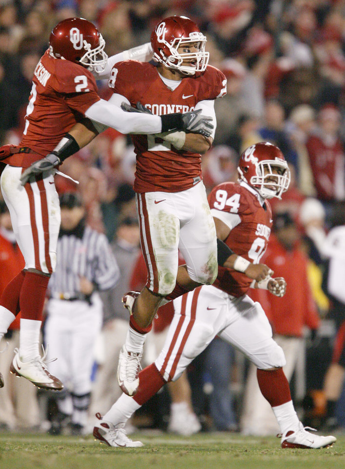 OU\'s Travis Lewis, center, Brian Jackson, left, and Pryce Macon celebrate during the college football game between the University of Oklahoma Sooners and Texas Tech University at Gaylord Family -- Oklahoma Memorial Stadium in Norman, Okla., Saturday, Nov. 22, 2008. BY BRYAN TERRY, THE OKLAHOMAN