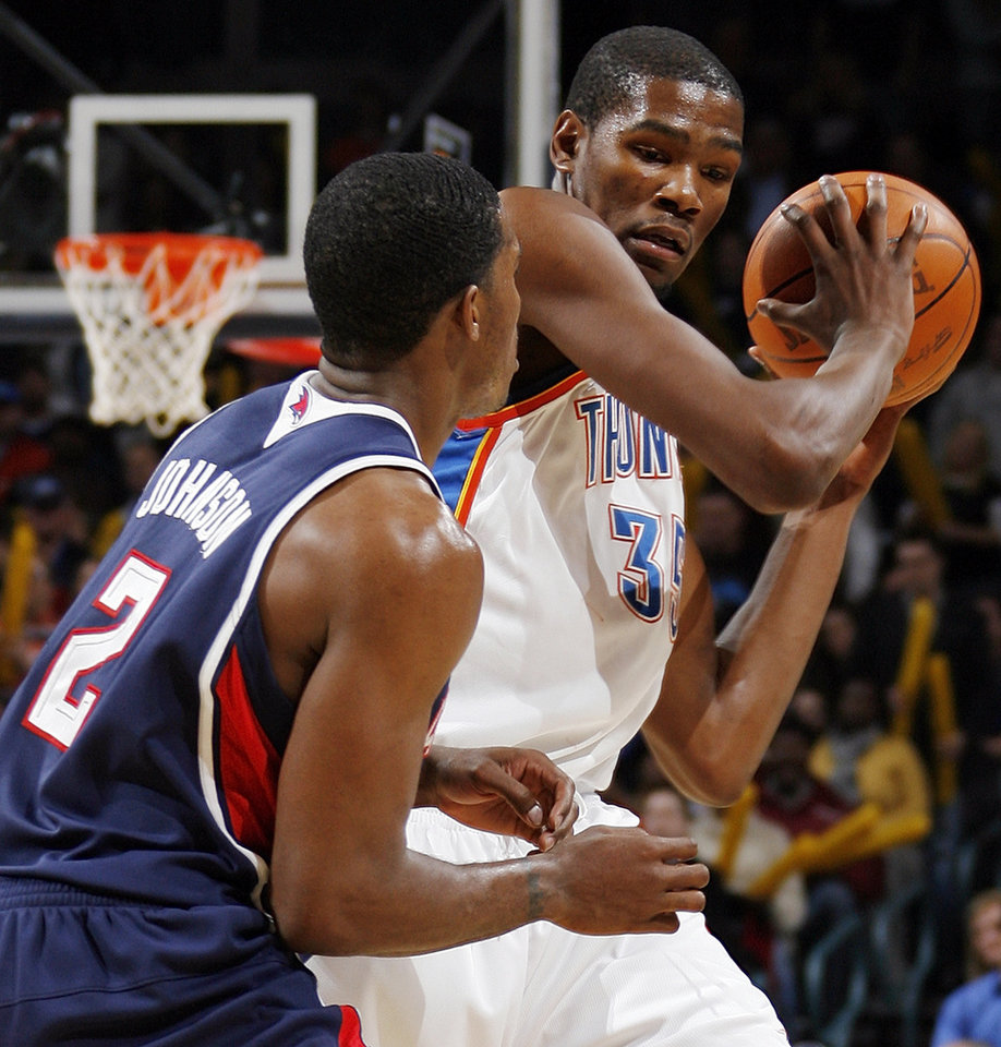 Kevin Durant (35) of Oklahoma City keeps the ball away from Joe Johnson (2) of Atlanta during the NBA basketball game between the Atlanta Hawks and the Oklahoma City Thunder at the Ford Center in Oklahoma City, Tuesday, February 2, 2010. The Thunder won, 106-99. Photo by Nate Billings, The Oklahoman