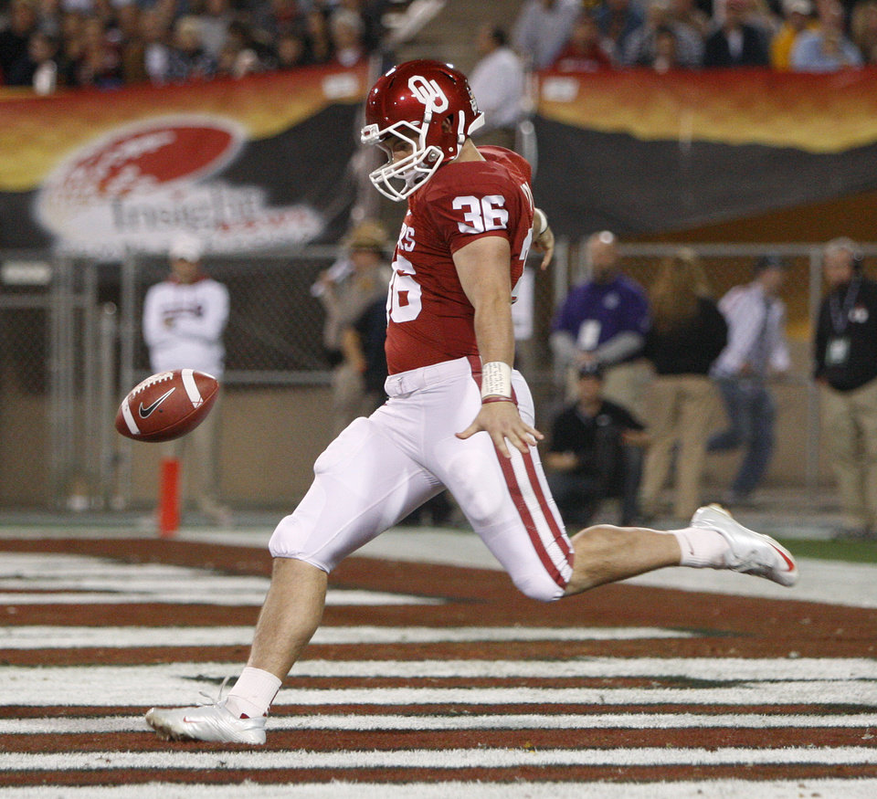 Photo -   KICKING GAME: A       Tress Way's punting - 50-yard average on six kicks - was the game's most impressive statistic. Way, pictured here, constantly pinned the Hawkeyes deep or kicked OU out of trouble. Way even made a tackle on an Iowa punt return. Also, kickoff returns of 52 yards by Trey Franks and 35 yards by Brennan Clay gave the Sooners good field position. And Michael Hunnicut's 35-yard field goal with 2:28 left iced the game. Run defense: B. The Hawkeyes got just 78 yards on 29 carries from their tailbacks and gave up no big plays. But remember two things. The Hawkeyes were without leading rusher Marcus Coker, and even with Coker, Iowa wasn't a great running team. The Hawkeyes ranked last in the Big Ten in rushing. We said Iowa liked to run the ball. We never said the Hawkeyes were good at it.
