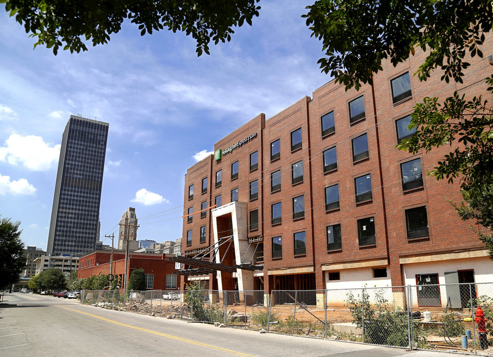 Photo -  Main Street, historically a sleepy street in Bricktown, is expected to become more lively once the Holiday Inn Express, 101 E Main, opens this fall.    Jim Beckel -  THE OKLAHOMAN
