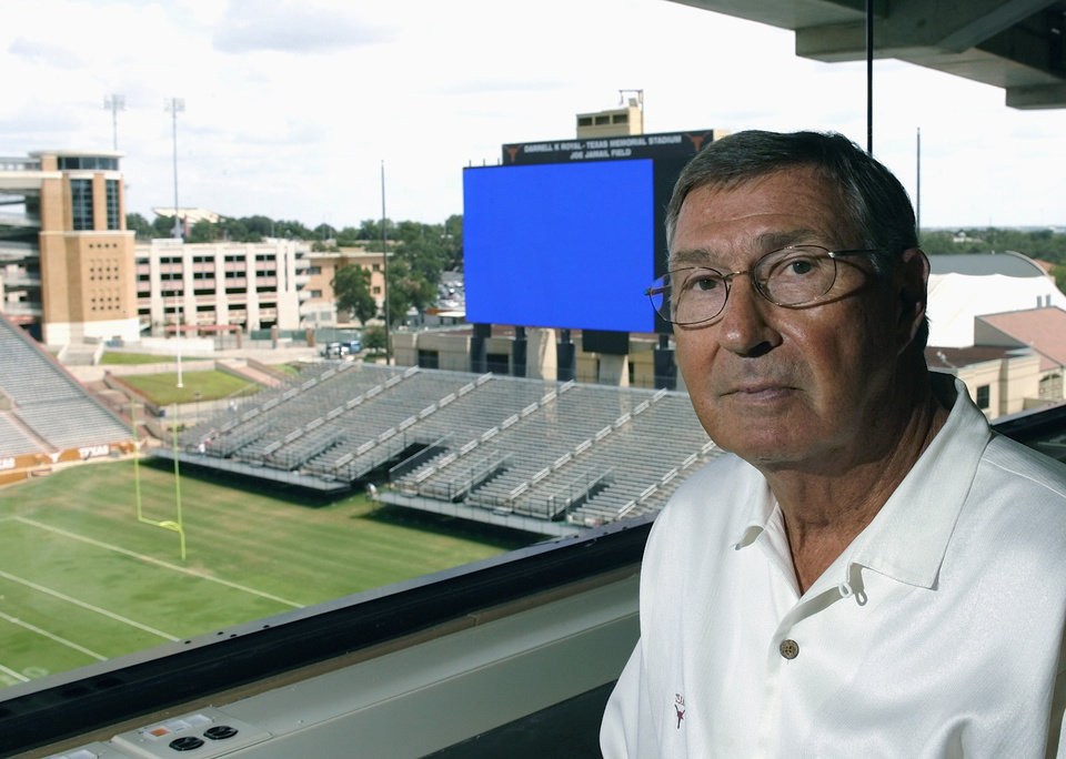 University of Texas Athletics Director DeLoss Dodds is shown in the football stadium's improved press box Tuesday, Aug. 22, 2006, in Austin, Texas. The giant scoreboard and bleachers for over 4,000 in the background are also additions for the coming seven home game season. (AP Photo/Harry Cabluck)