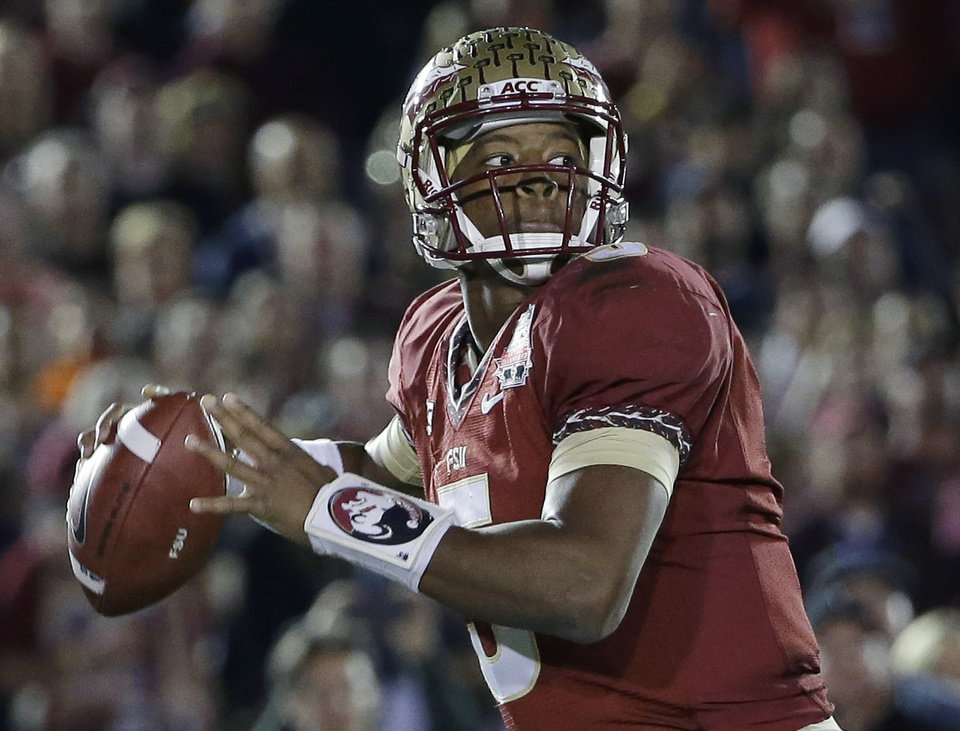 Photo -  FILE - In this Jan. 6, 2014, file photo, Florida State's Jameis Winston (5) throws during the first half of the NCAA BCS National Championship college football game against Auburn in Pasadena, Calif. Winston and defending national champion Florida State are No. 1 in The Associated Press preseason college football poll. (AP Photo/David J. Phillip, File)