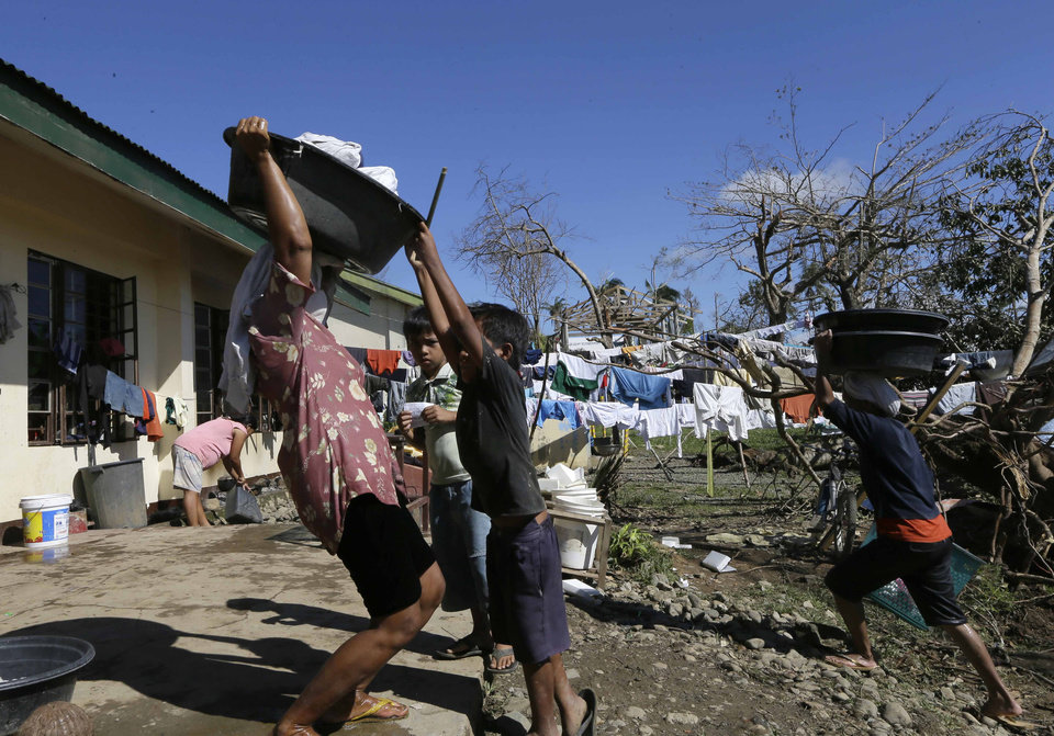 Photo - Typhoon evacuees prepare to do their laundry at an evacuation center at Maparat township, Compostela Valley in southern Philippines Saturday Dec. 8, 2012. Search and rescue operations following typhoon Bopha that killed nearly 600 people in the southern Philippines have been hampered in part because many residents of this ravaged farming community are too stunned to assist recovery efforts, an official said Saturday. (AP Photo/Bullit Marquez)